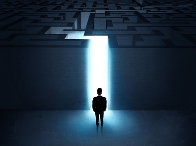 A businessman at the entrance to a maze