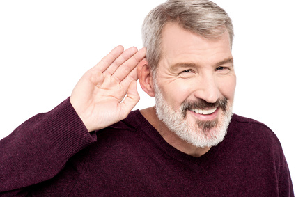 Mature man cupping hand behind ear