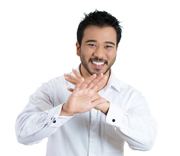 Closeup portrait, handsome, modest, young smiling man putting hands out, thank you for the compliment, but i'm not that good, isolated white background. Positive human emotion facial expression