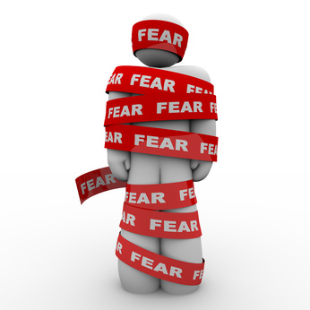 Scared Afraid Man Wrapped in Red Fear Tape