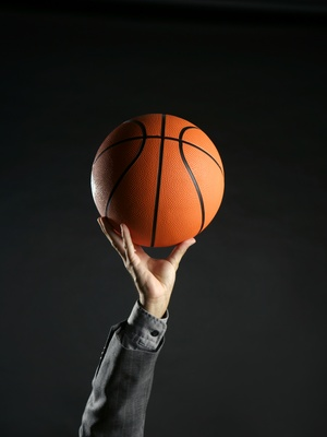 Businessman with basketball ball, teamwork, leadership