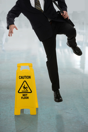 Businessman Slipping on Wet Floor